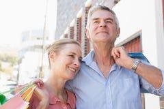 Happy senior couple shopping in the city Stock Photos