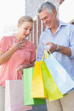 Happy senior couple shopping in the city Stock Images