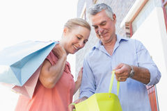 Happy senior couple shopping in the city Stock Photography