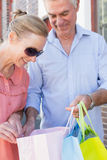 Happy senior couple shopping in the city Royalty Free Stock Image