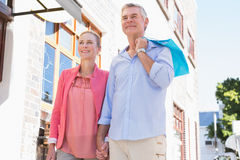 Happy senior couple shopping in the city Stock Photo