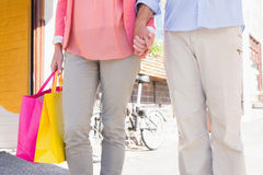 Happy senior couple shopping in the city Royalty Free Stock Photos
