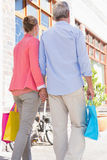 Happy senior couple shopping in the city Stock Image