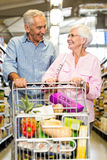 Happy senior couple shopping together Royalty Free Stock Images