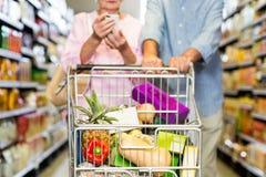 Happy senior couple shopping together Stock Image