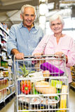 Happy senior couple shopping together Stock Image