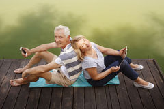 Happy senior couple at shore Stock Photography