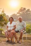 Happy Senior couple sitting outdoors Royalty Free Stock Image