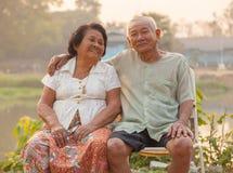 Happy Senior couple sitting outdoors Royalty Free Stock Photo