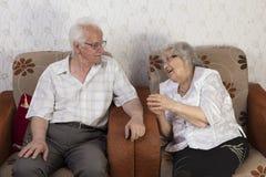Happy Senior Couple Sitting On Sofa Royalty Free Stock Images