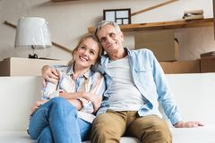 happy senior couple sitting together and embracing royalty free stock photography