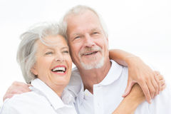 Happy senior couple. Happy and smiling couple in front of white sky Stock Images