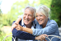 Happy senior couple smiling and having good time in garden Stock Photo