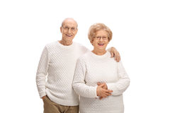 Happy senior couple smiling and looking at the camera Royalty Free Stock Photography
