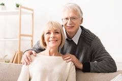 Happy senior couple smiling and looking at camera stock photography