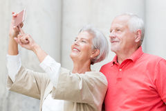 Happy senior couple. Smiling senior couple make a selfie Stock Images