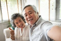 Senior Couple taking selfie photos with smartphone stock images