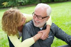 Happy senior couple smiling together outdoors Stock Photos