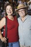 Happy Senior Couple At Souvenir Shop Stock Photos