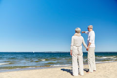 Happy senior couple on summer beach Royalty Free Stock Images