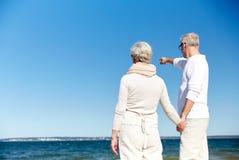 Happy senior couple on summer beach Stock Photography