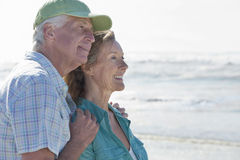 Happy senior couple on sunny beach royalty free stock images
