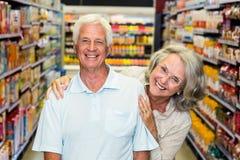 Happy senior couple at the supermarket Royalty Free Stock Photo