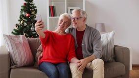Happy senior couple taking christmas selfie stock video footage