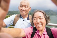 Happy senior couple taking picture with smart phone selfie Stock Photo