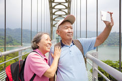 Happy senior couple taking picture with smart phone selfie Stock Photography