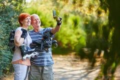 Happy senior couple taking a selfie Stock Photography