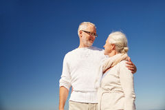 Happy senior couple talking outdoors Stock Images