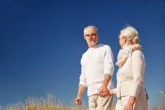 Happy senior couple talking outdoors Royalty Free Stock Photos