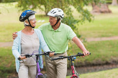 Happy senior couple on their bike Stock Image