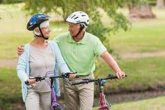 Happy senior couple on their bike Stock Image