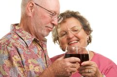 Happy Senior Couple Toasting Royalty Free Stock Images