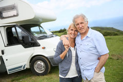 Happy senior couple on a travel with camping car Royalty Free Stock Image