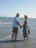 Happy Senior Couple On Tropical Beach Stock Photo