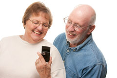 Happy Senior Couple Using Cell Phone Stock Photos