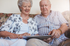 Happy senior couple using digital tablet Royalty Free Stock Images
