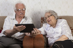 Happy Senior Couple Using Tablet Computer Stock Images