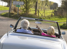 Happy Senior couple in vintage sports car Stock Images