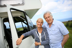 Happy senior couple visiting with camping car Royalty Free Stock Photography