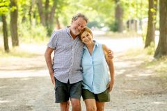 Free Happy Senior Couple Walking And Enjoying Life Outdoors Stock Photography - 121555352
