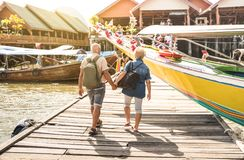 Happy senior couple walking holding hand at Koh Panyi muslim flo. Happy senior couple walking at Koh Panyi muslim floating village - Active elderly and travel royalty free stock photography