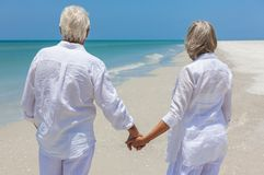 Happy Senior Couple Walking Holding Hands Tropical Beach Stock Photography