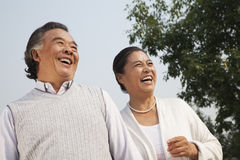 Happy senior couple walking outdoors in Beijing Royalty Free Stock Image