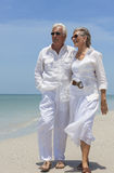 Happy Senior Couple Walking by Sea on Tropical Beach Royalty Free Stock Photography