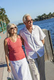 Happy Senior Couple Walking Tropical Sea or River Royalty Free Stock Photos