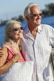 Happy Senior Couple Walking Tropical Sea or River Royalty Free Stock Photo